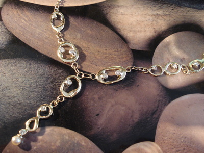 Long molten solid 9ct gold links, with round brilliant-cut diamonds sprinkled through links, necklace