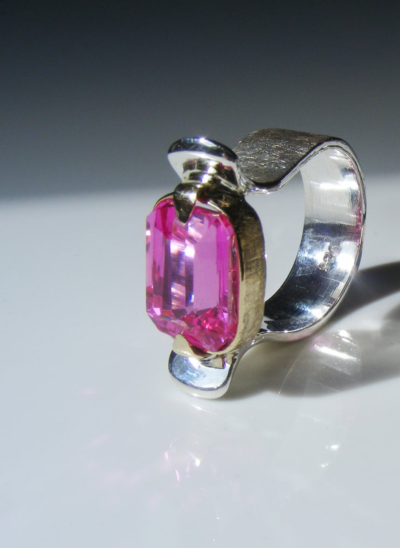 Pink topaz, silver & gold ring