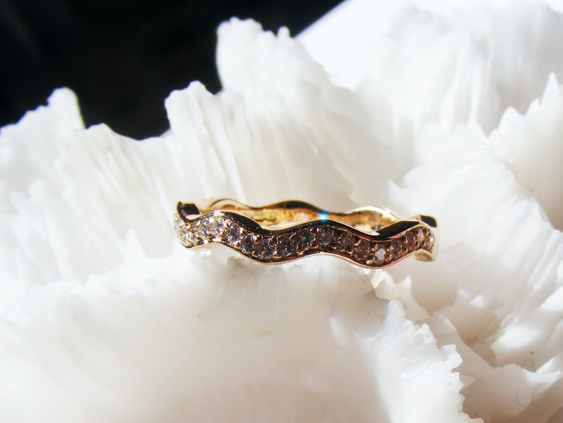 wavy diamond & rose gold eternity ring