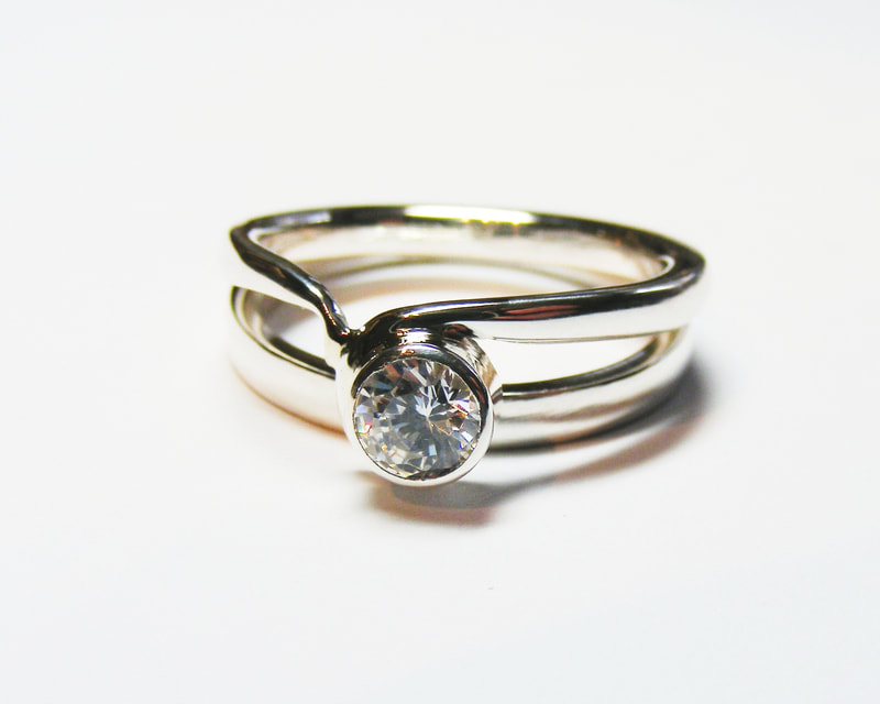 platinum & diamond shaped single stone ring