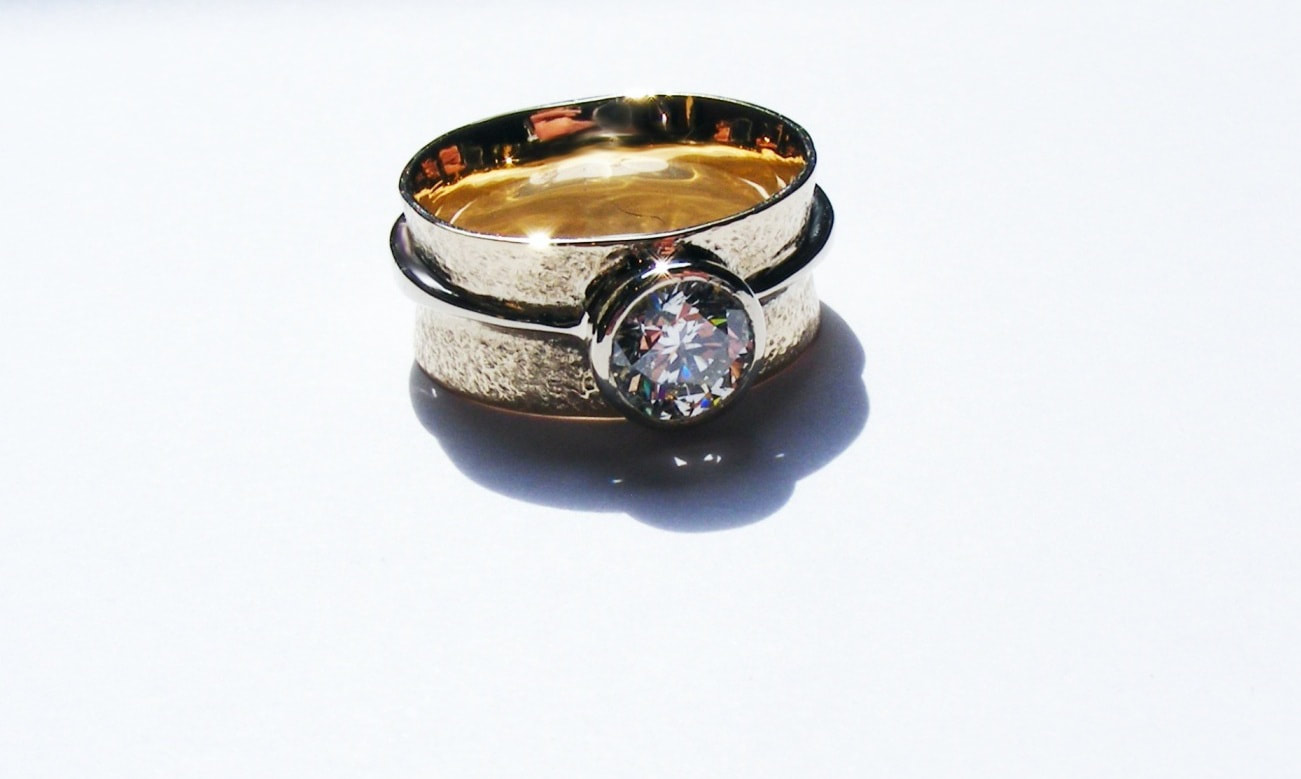 Barrel shaped, coloured diamond, wide band ring