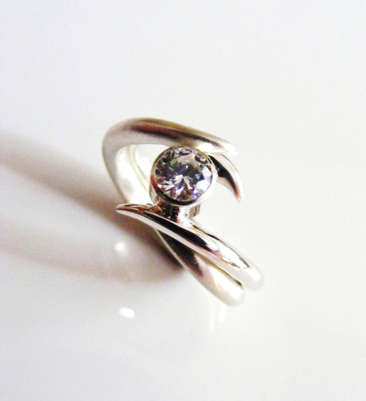 Entwined platinum & diamond ring