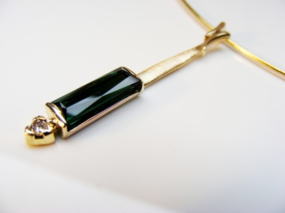 Natural Dark green long tourmaline pendant, with 9ct gold & natural, conflict-free diamond, on cable necklet
