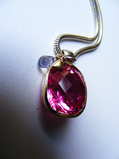 Huge, bold, natural fushia pink topaz, cushion-cut, wrapped in gold with natural sapphire briolette droplet, on silver slinky chain