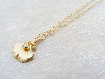 9ct gold 'Ginko' pendant with tiny natural diamond droplet, on fine 9ct gold chain.