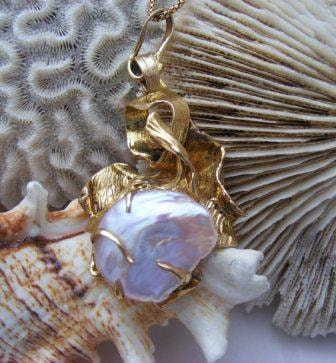 Huge Natural rare baroque Pearl in heavy 'crashing waves' gold pendant setting