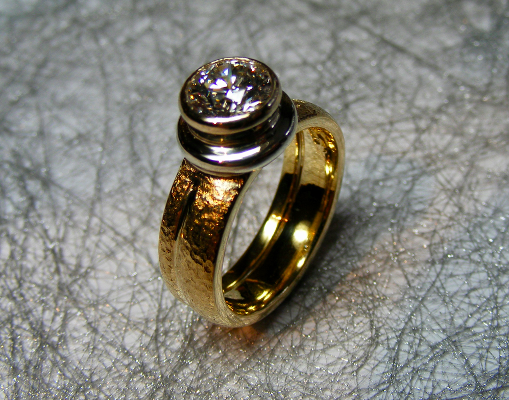 hero textured gold ring with bold rubover setting diamond
